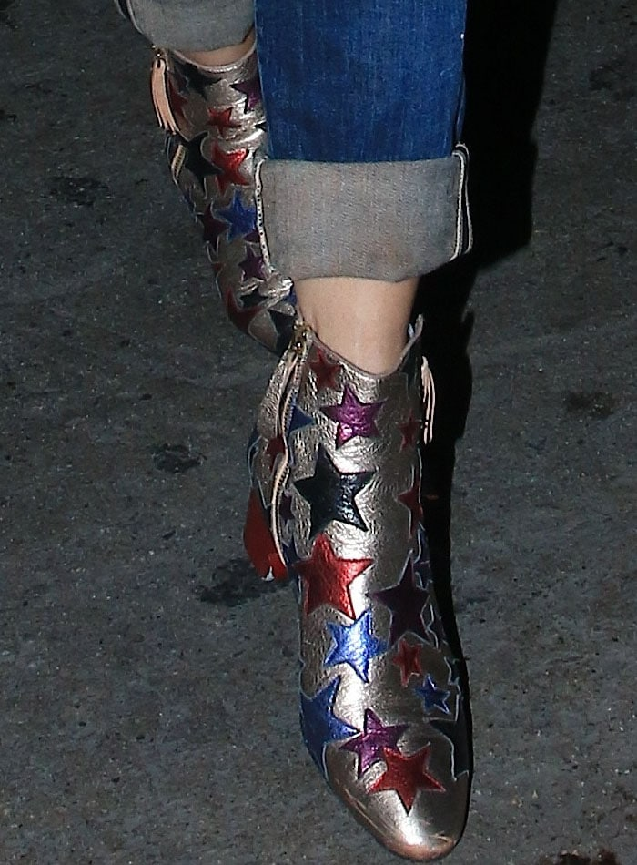 Rita Ora wears a pair of Tommy Hilfiger boots for her evening of dancing at the club