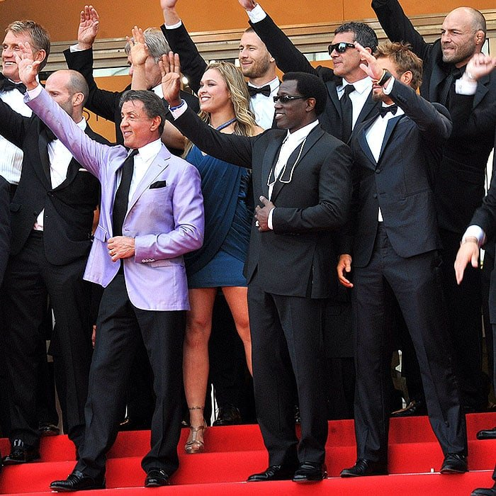 """Ronda Rousey in the middle of her co-stars in """"The Expendables 3"""" at the 67th Annual Cannes Film Festival in Cannes, France, on May 18, 2014"""