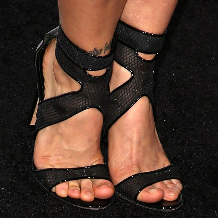 Ronda Rousey's pretty feet in black mesh sandals with black patent piping at the edges