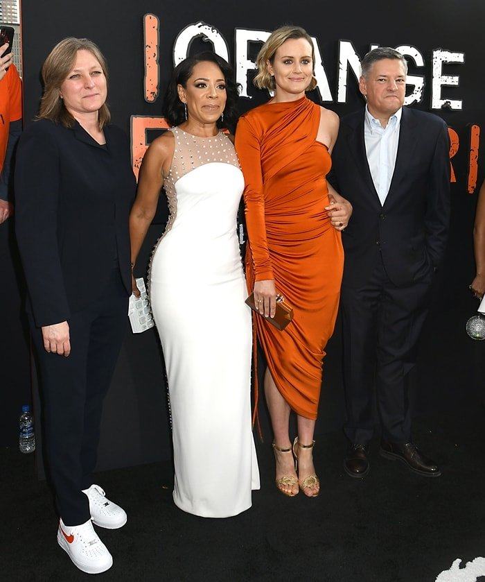 Cindy Holland, Selenis Leyva, Taylor Schilling, and Ted Sarandos walk the red carpet at the Orange Is the New Black final season premiere