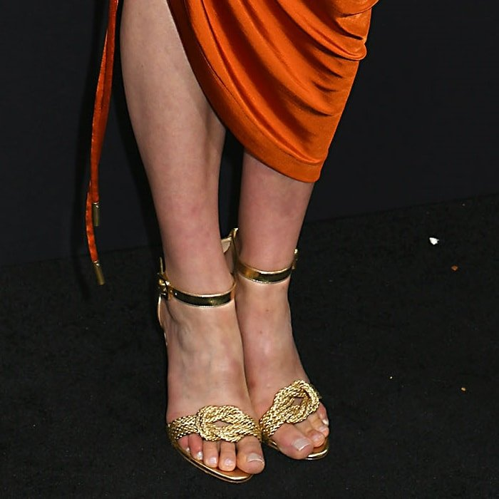 Taylor Schilling's pretty feet in gold Vicky sandals from Alexandre Birman