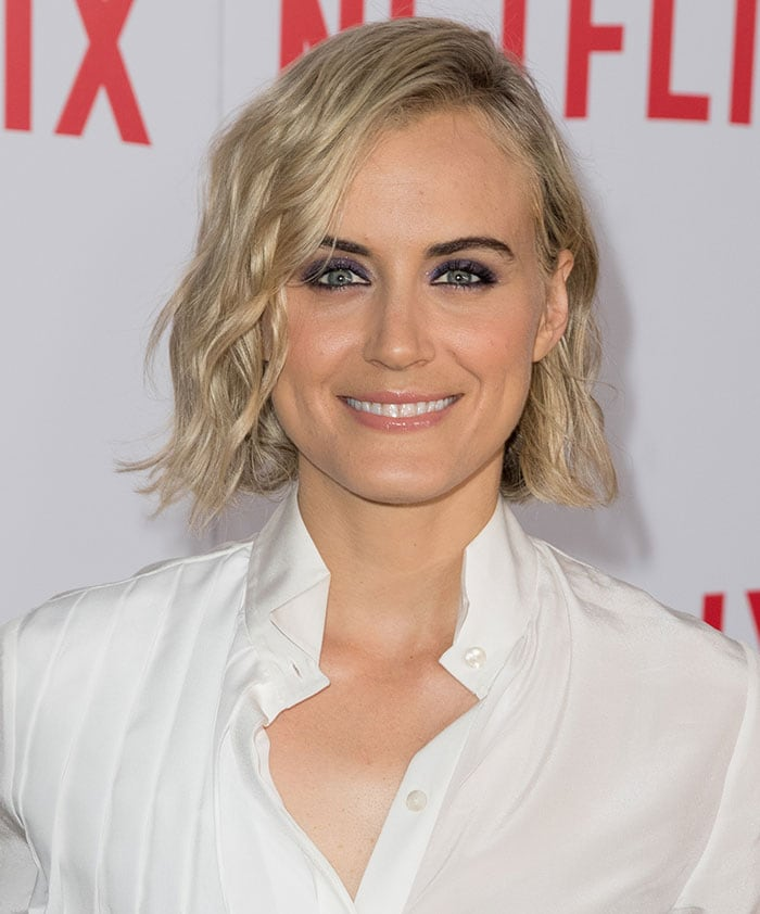 Taylor Schilling with a side-parted loose wavy hairstyle