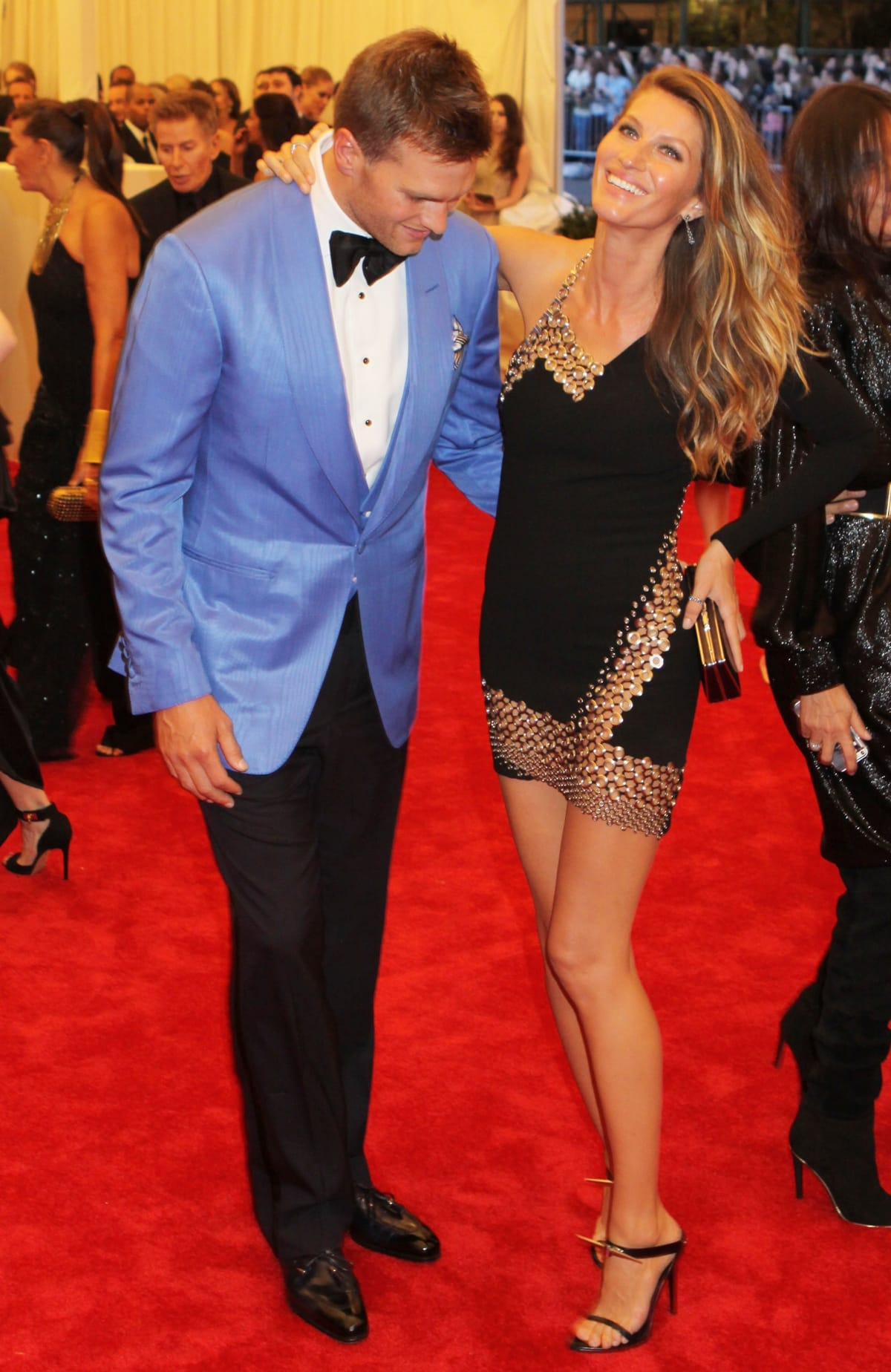 Gisele Bündchen in a black Anthony Vaccarello dress and Tom Brady in a blue suit jacket at the 2013 Met Gala