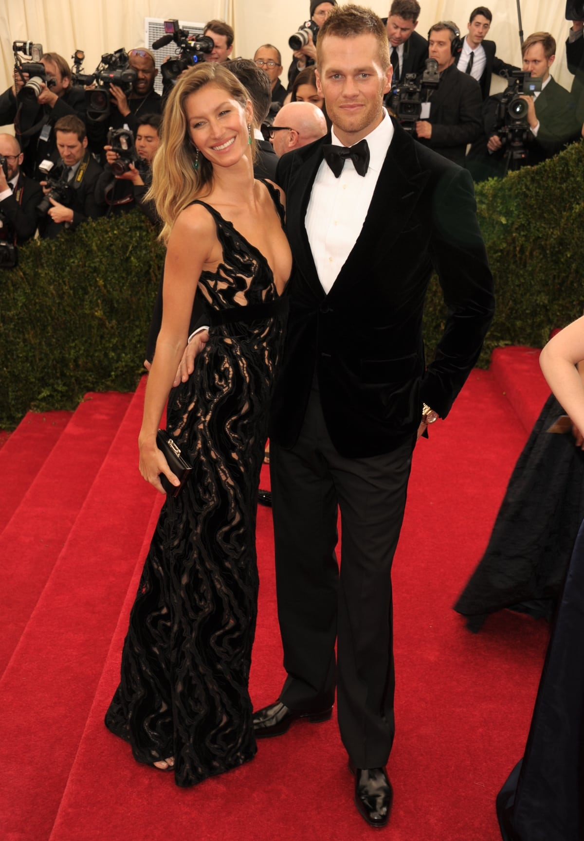 Gisele Bündchen in a plunging black velvet Balenciaga gown with Tom Brady at the 2014 Met Gala