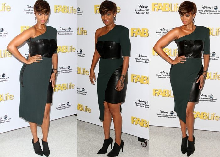 Tyra Banks flaunted her legs in a leather bustier dress by Bryan Hearns