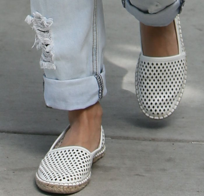 Vanessa Hudgens shows off the laser-cut detailing on her Dolce Vita shoes