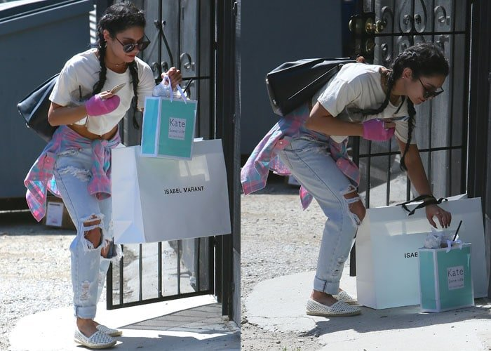 Vanessa Hudgens juggles Isabel Marant and Kate Sommerville shopping bags in a pair of ripped jeans
