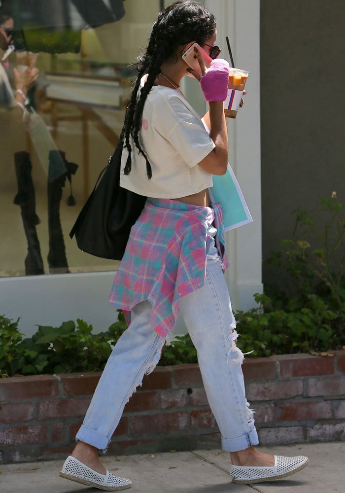 Vanessa Hudgens leaves Kate Somerville after her skin appointment in double french braids and a casual outfit