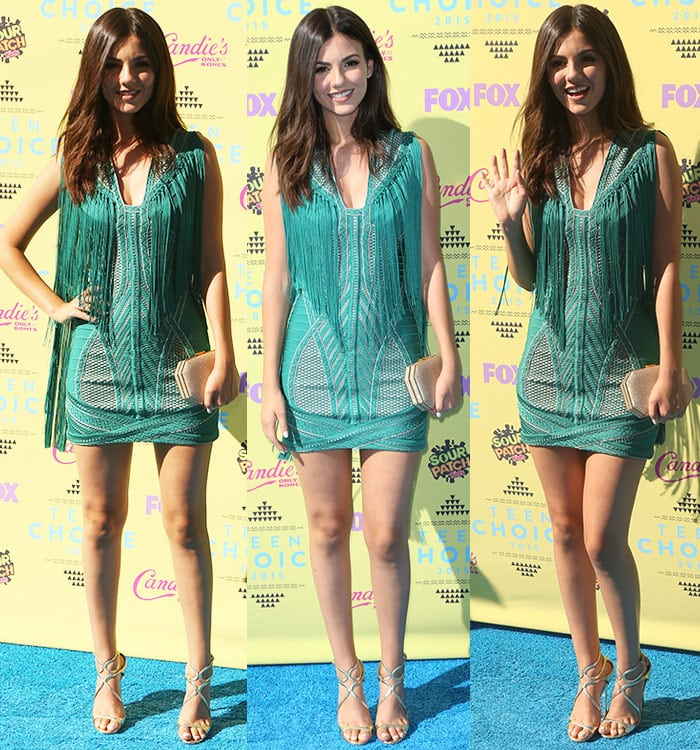 Victoria Justice showed her playful style in a tight-fitting Herve Leger by Max Azria mini dress featuring a low-cut neckline and a thigh-skimming short hem