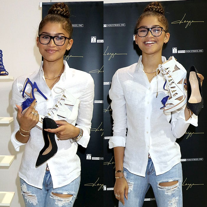 Zendaya holding up more pairs of her Daya shoes