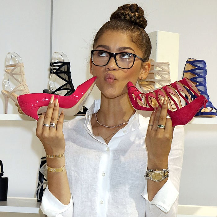 Zendaya Coleman goofing around with pink shoes from her Daya shoe collection