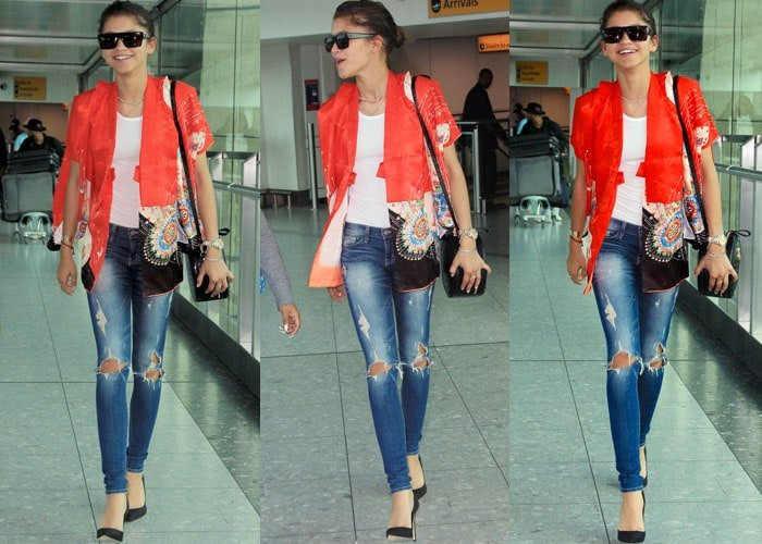 Zendaya rocks ripped jeans with a white tee and an oriental cover-up