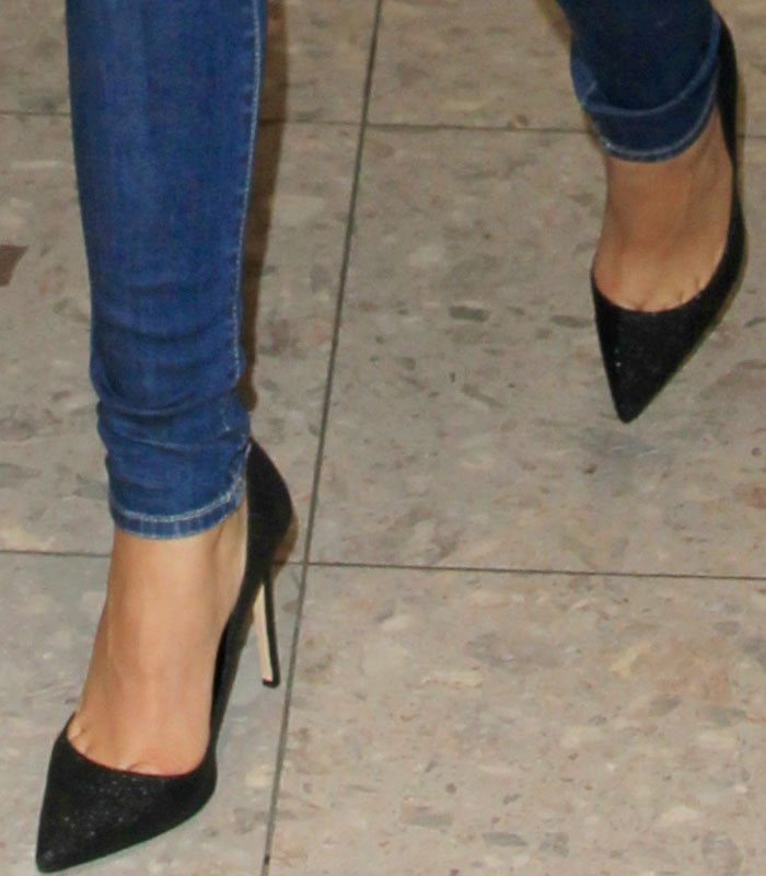 Zendaya shows off her feet in black glitter pumps from her own shoe line