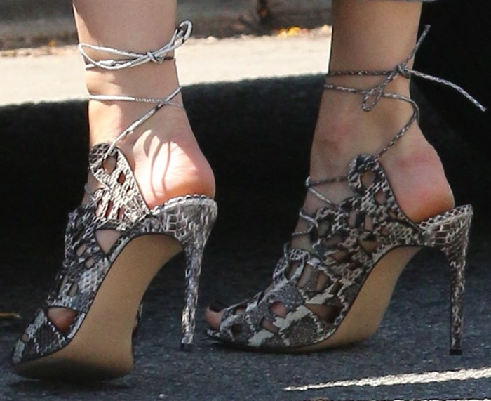 Emmy Rossum's chic snakeskin lace-up sandals