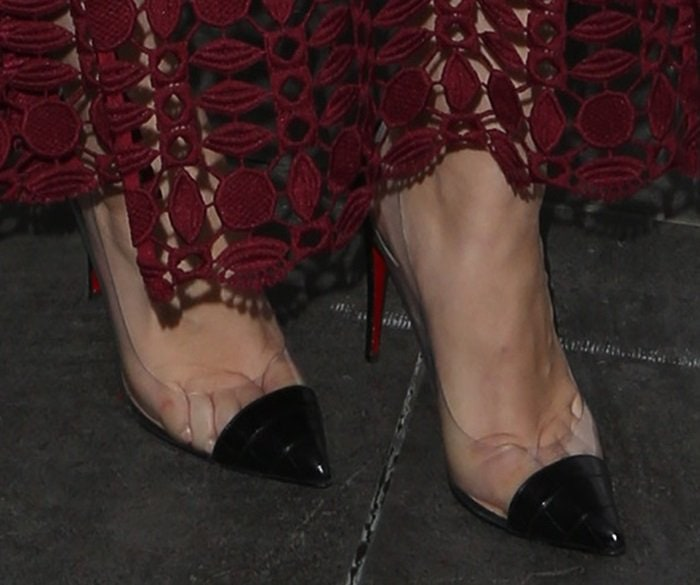 Holland Roden crams her toes into a pair of PVC pumps from Christian Louboutin