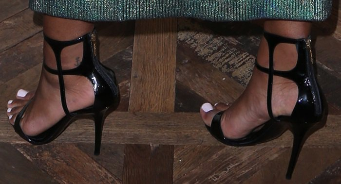 Keke Palmer's anchor tattoo peeks out from behind the black patent straps of her Tamara Mellon sandals