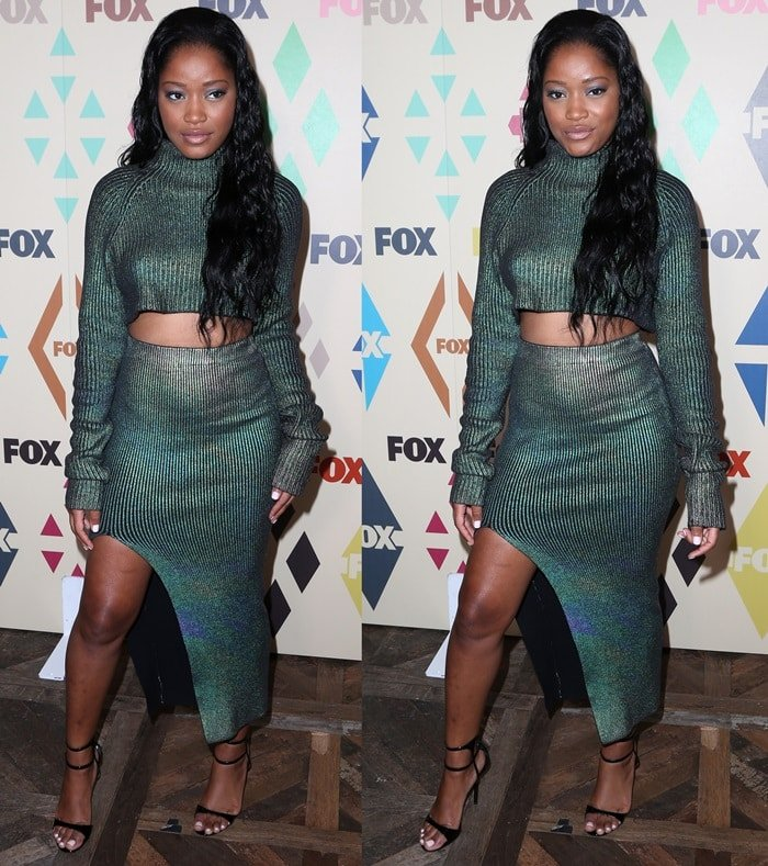 Keke Palmer throws a sultry look from beneath her long, wavy, dark hair as she poses for the cameras