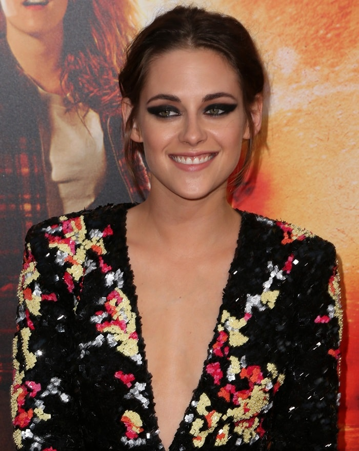 Kristen Stewart with heavy eye makeup and a messy up-do