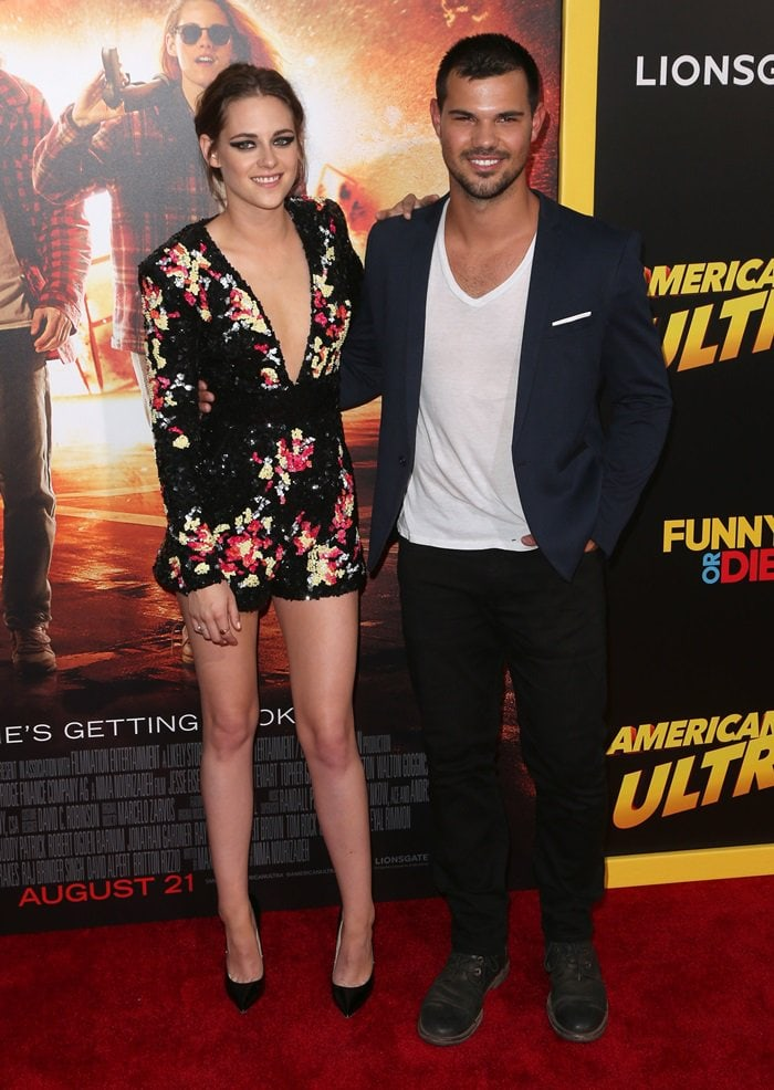 Kristen Stewart with Taylor Lautner at the premiere of 'American Ultra'