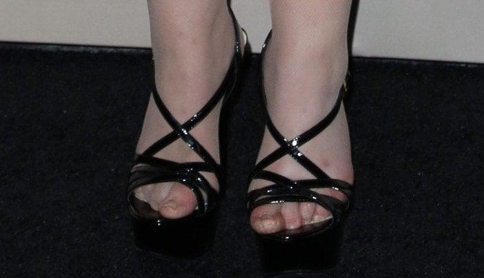 Abigail Breslin's feet in strappy black platform heels
