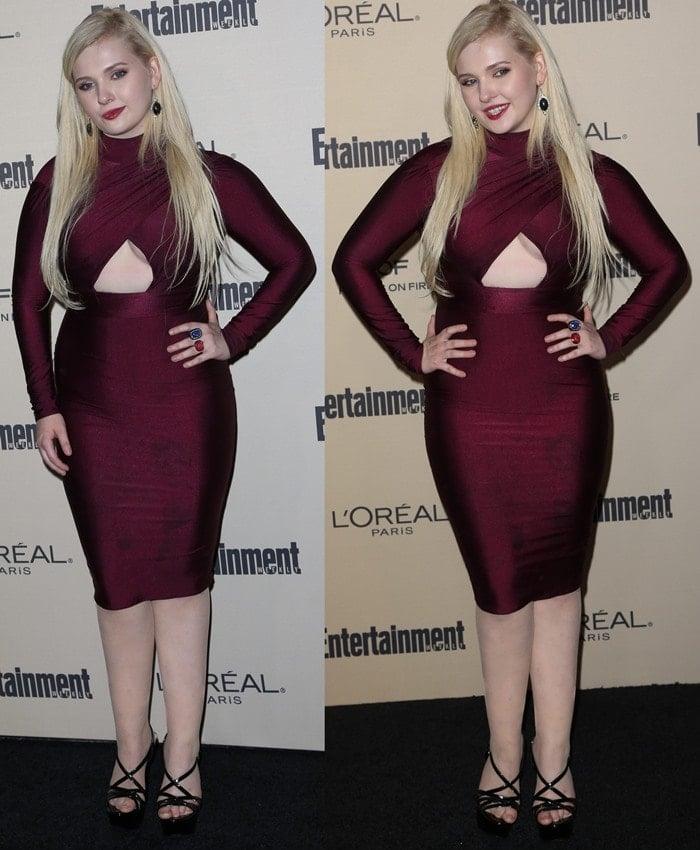 Abigail Breslin wears an unflattering crimson dress on the black carpet