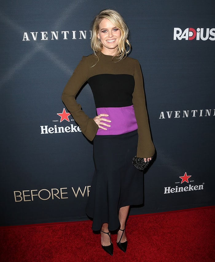 Alice Eve poses on the red carpet in an ill-fitting Marni dress