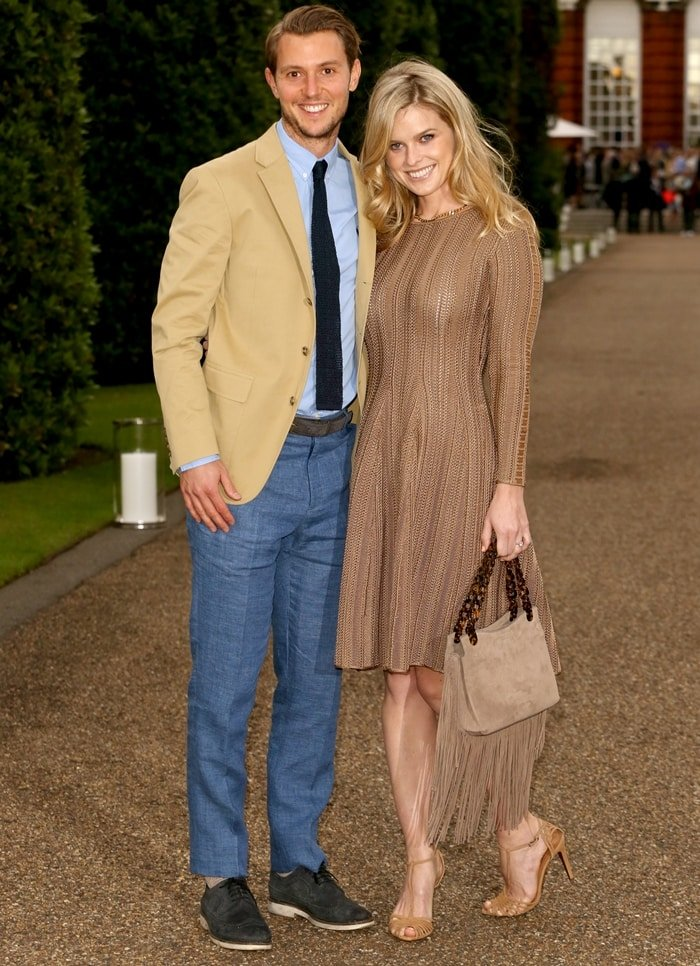 Alice Eve and Alex Cowper-Smith attend the Vogue and Ralph Lauren Wimbledon party