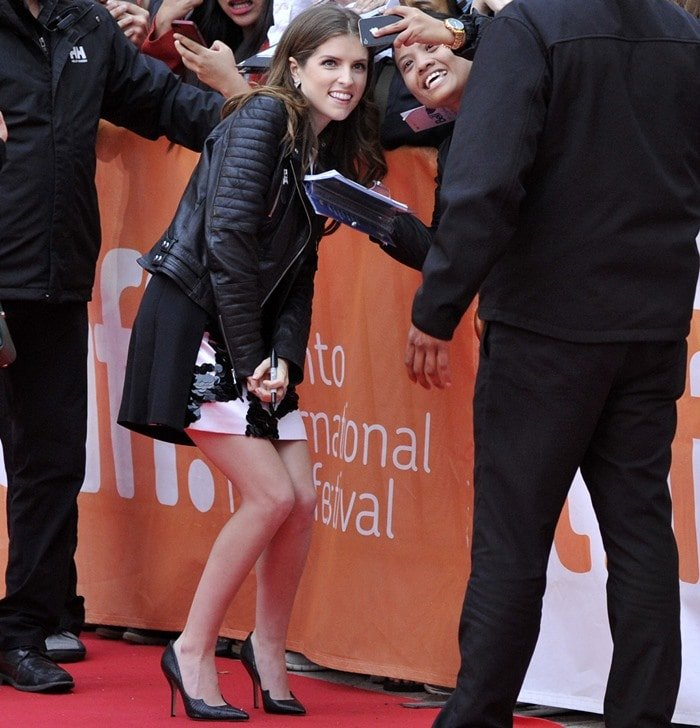 Anna Kendrick poses for a selfie with a fan at the Toronto International Film Festival