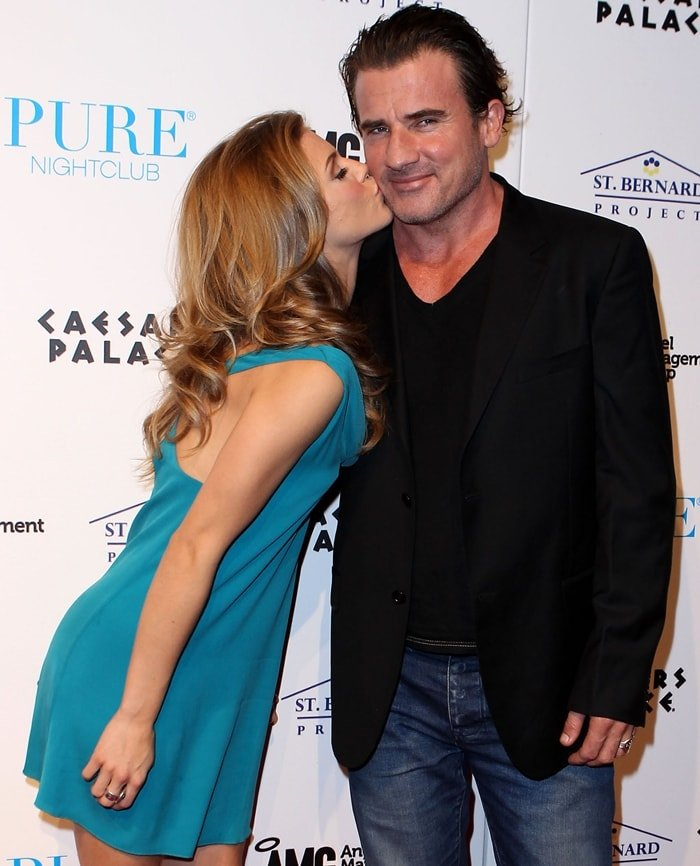 AnnaLynne McCord gives her boyfriend Dominic Purcell a kiss