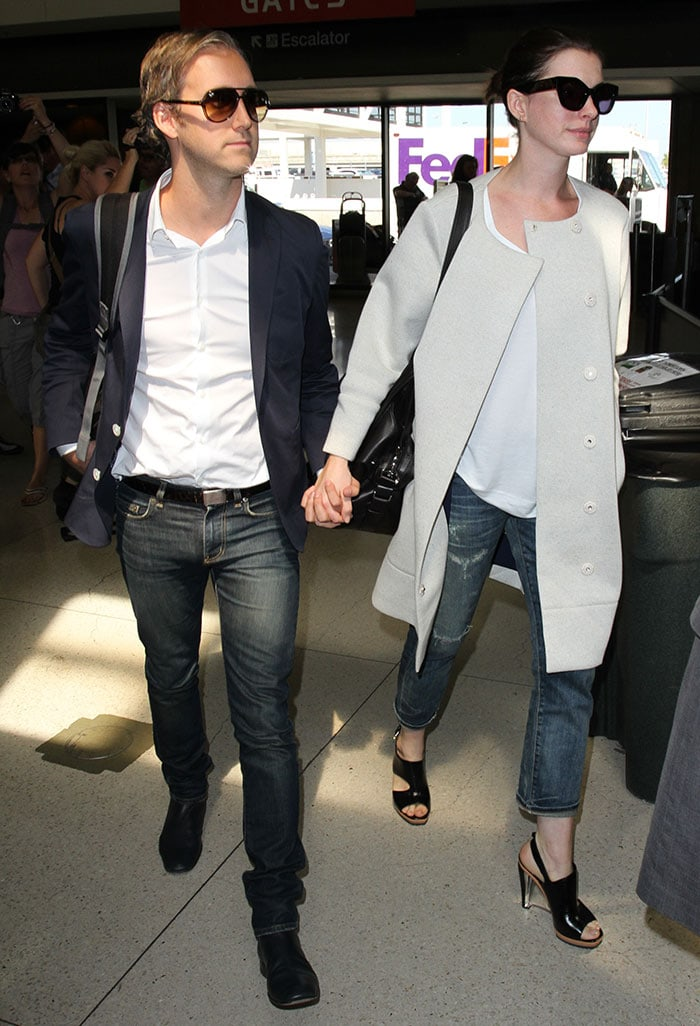 Anne Hathaway and husband Adam Shulman wear matching smart-casual looks at LAX