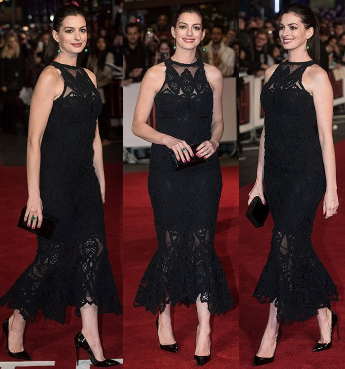 Anne Hathaway is all smiles as she struts the red carpet in a pair of Christian Louboutin pumps