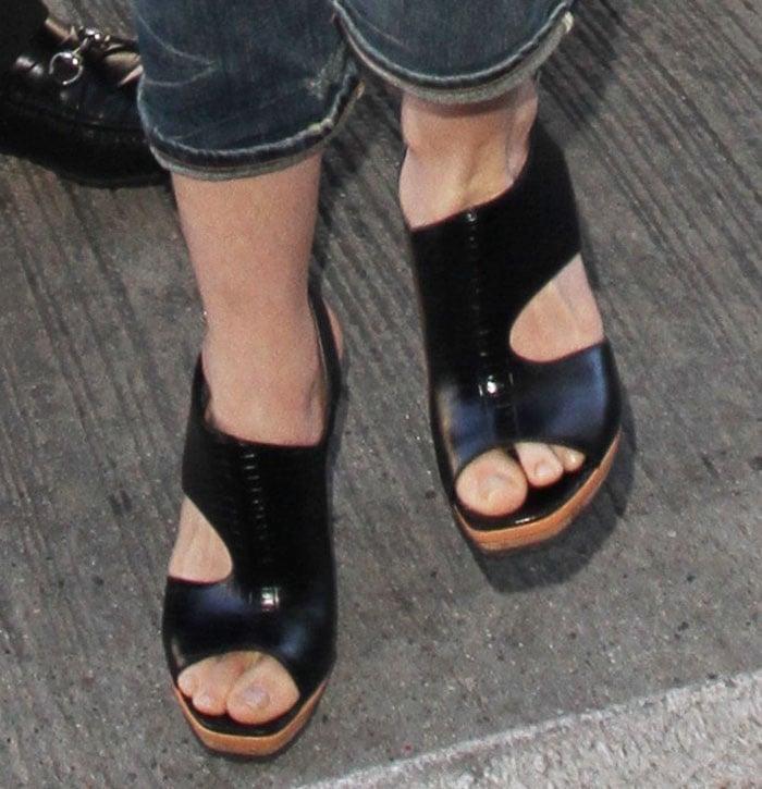 Anne Hathaway wears a pair of Rodarte cutout sandals on her feet