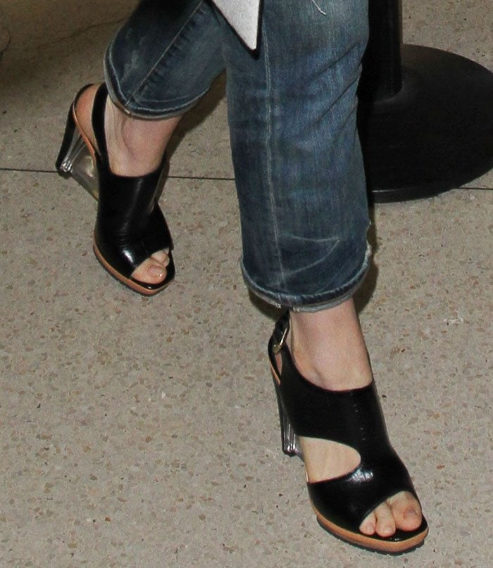 Anne Hathaway shows off the Lucite wedge heels on her Rodarte sandals
