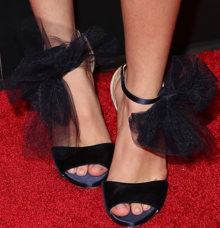 Bella Thorne shows off the tulle detailing on her Jimmy Choo heels