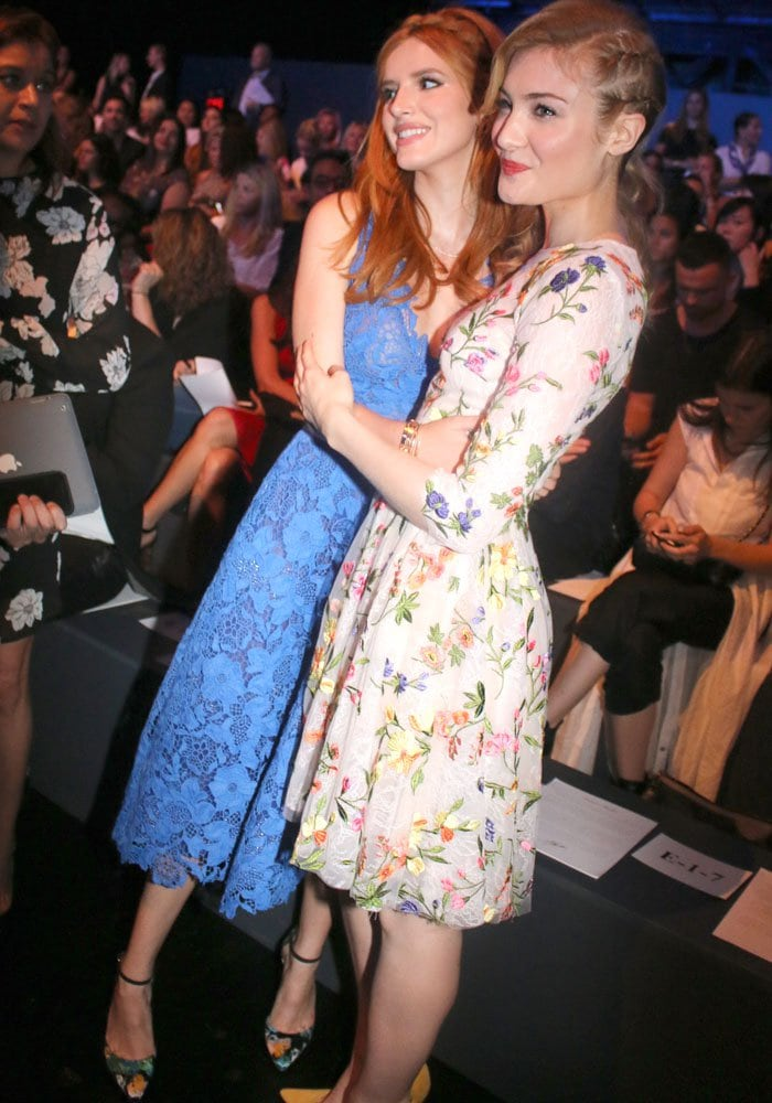 Bella Thorne and Skyler Samuels hug for the cameras while wearing dresses from Monique Lhuillier