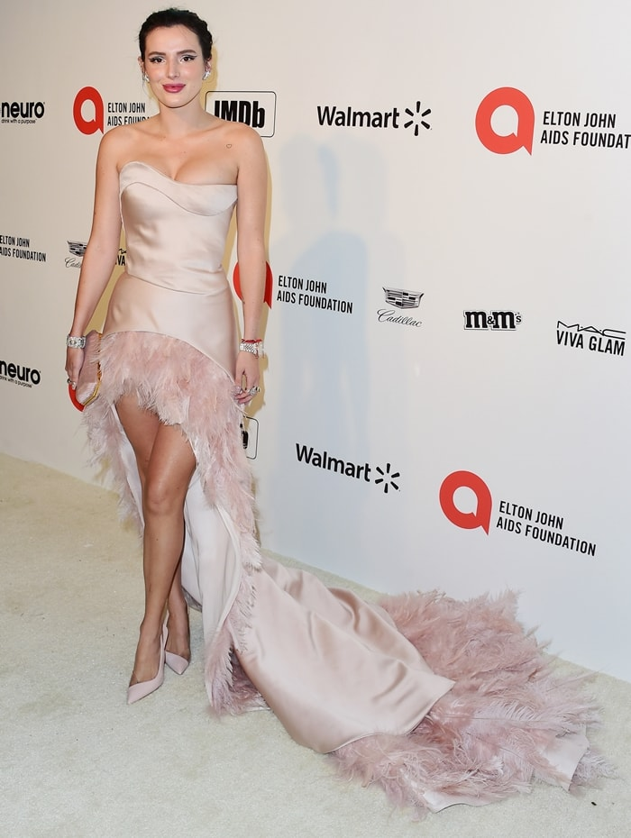 Bella Thorne wears a light pink Antonio Grimaldi Fall 2019 Couture feather dress with Neil Lane jewelry for the 2020 Elton John AIDS Foundation Oscars Viewing Party