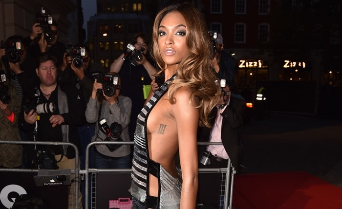 Jourdan Dunn with inked Roman numeral three on her left ribs at the GQ Men of the Year Awards