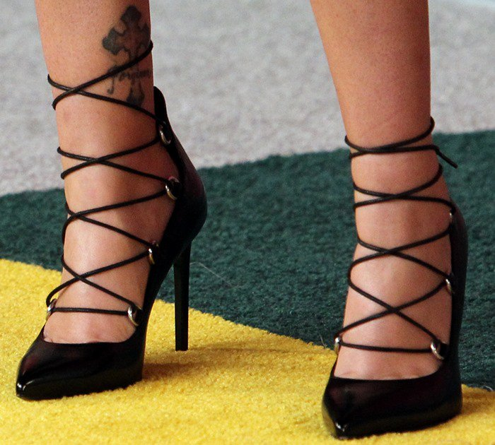 "Brandi Cyrus shows off an ankle tattoo in a lace-up pair of ""Paris"" pumps"