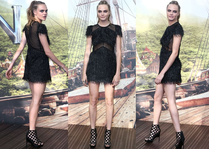"""Cara Delevingne shows off her high ponytail and short black dress as she promotes her new movie """"Pan"""""""