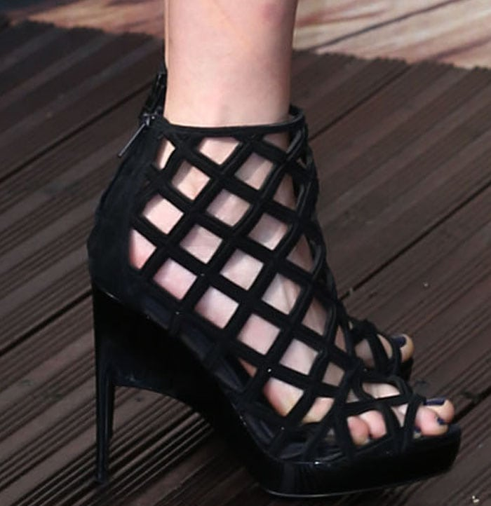 Cara Delvingne shows off her feet in a pair of caged sandals from Burberry