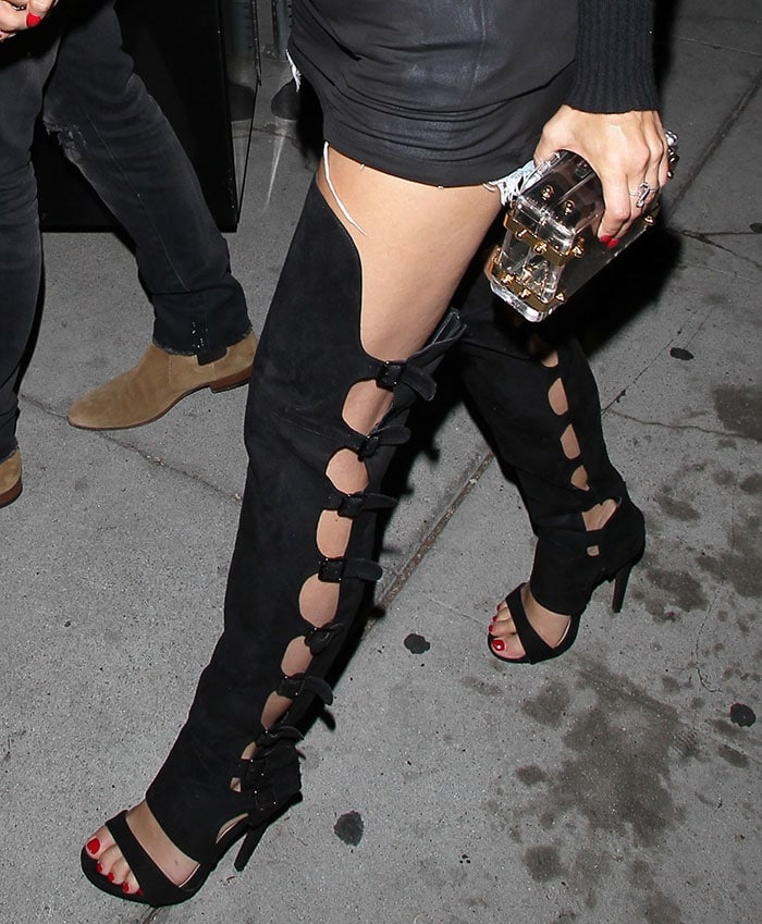 Cara Santana shows off her toes and sexy legs in thigh-high buckled boots