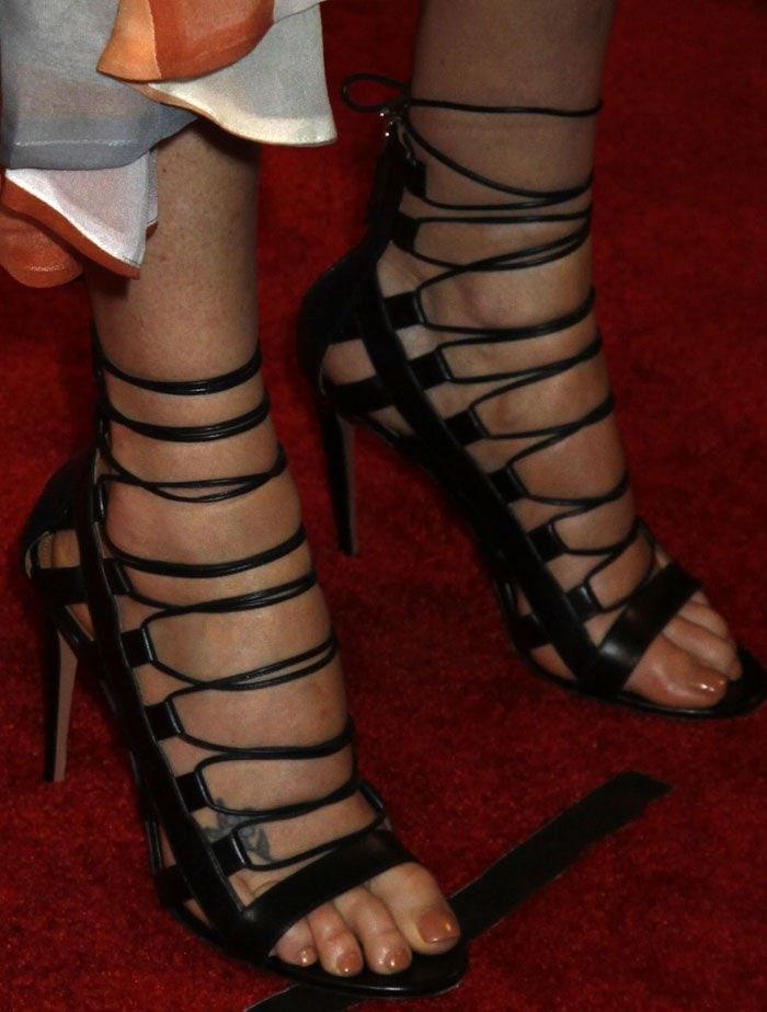"Charlize Theron in Aquazzura ""Amazon"" heels"