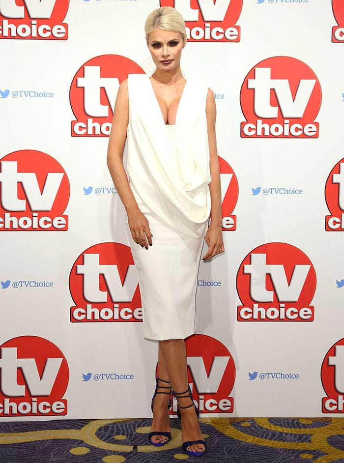 Chloe Sims went for a daring outfit, taking the plunge in a white AQ/AQ midi dress featuring a draped front and a cleavage-baring low-cut neckline