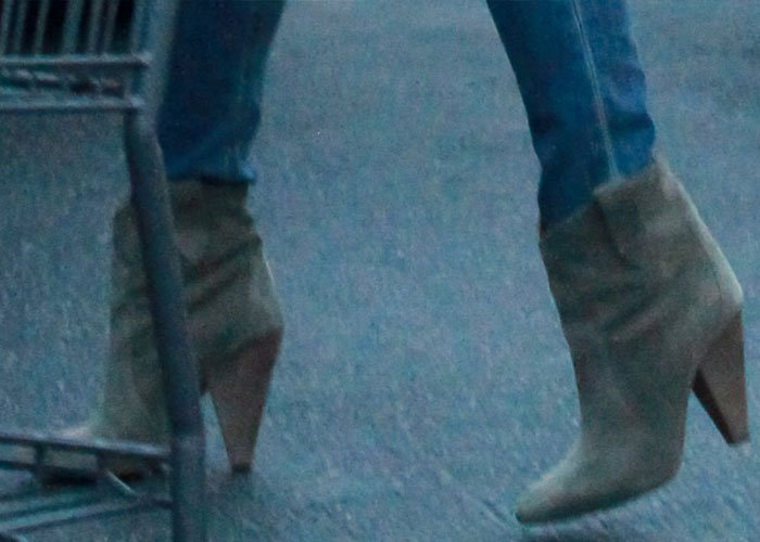 Chrissy Teigen wears Isabel Marant Roxann booties on her feet during a trip to the grocery store