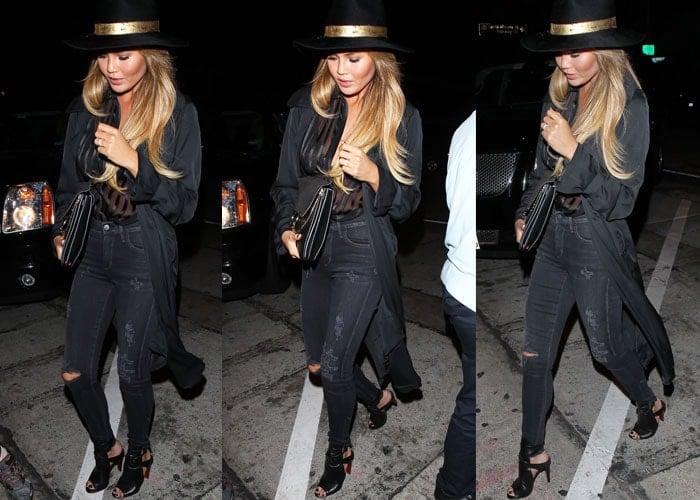 Model Chrissy Teigen wears an all-black outfit as she arrives for a dinner date
