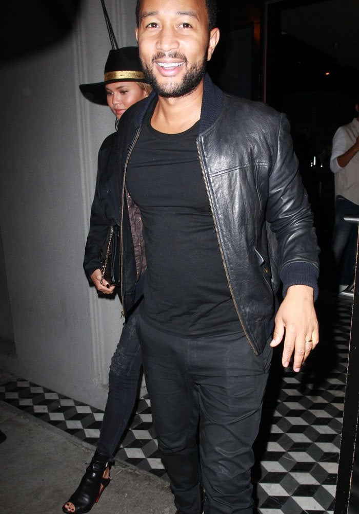 John Legend matches his wife Chrissy Teigen in an all-black outfit as the couple arrives at Craig's