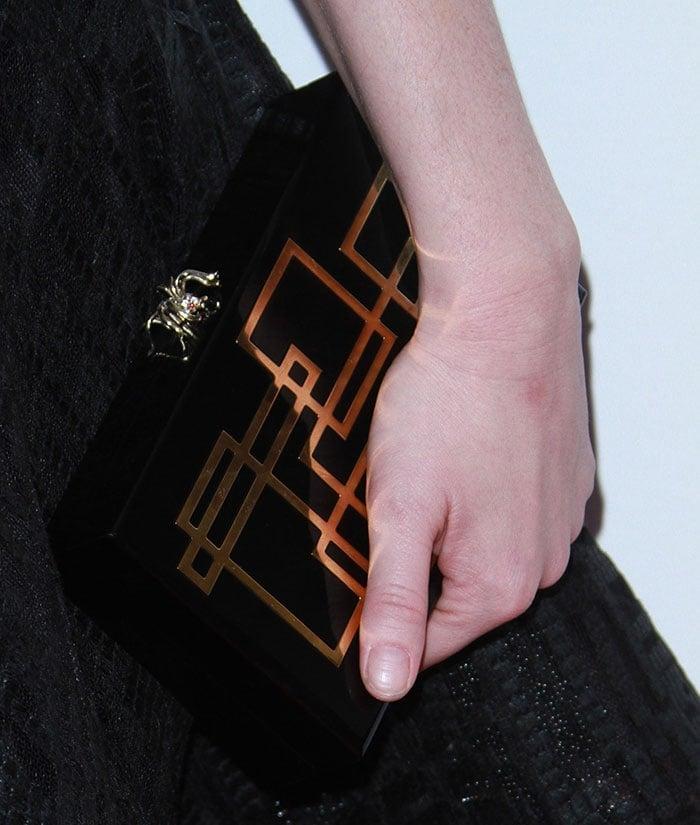 Christina-Hendricks-Charlotte-Olympia-spider-clasp-clutch