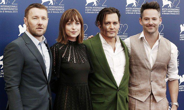 Joel Edgerton, Dakota Johnson, Johnny Depp, and Scott Cooper at a photo call for their upcoming film Black Mass