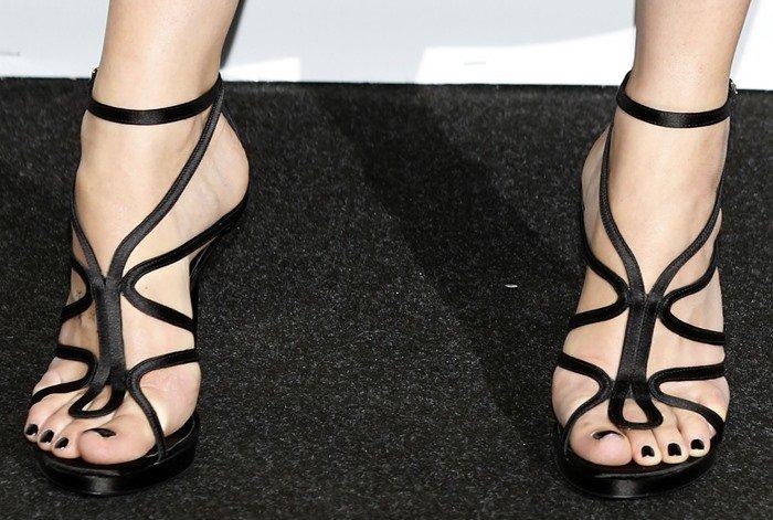 Dakota Johnson's sexy pedicured feet in black Roger Vivier sandals