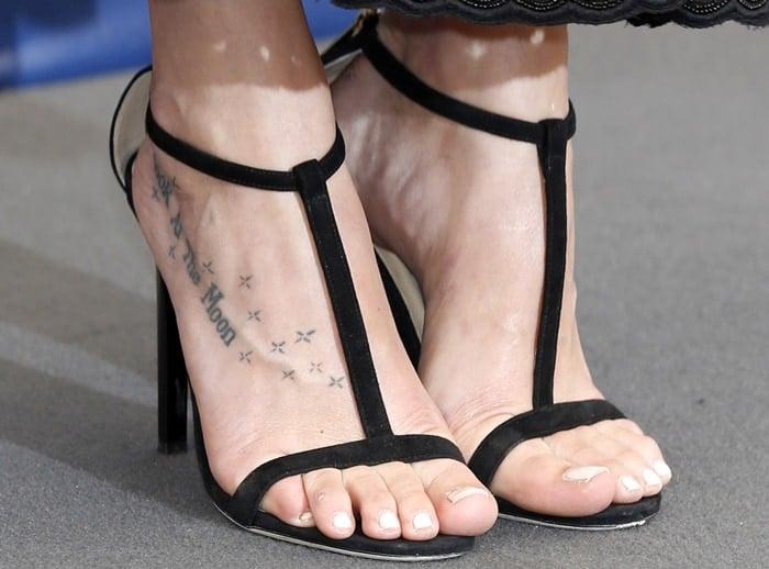 Dakota Johnson's sexy feet in Lucille sandals from Jimmy Choo
